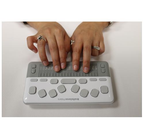 BrailleSense Polaris MINI with hands